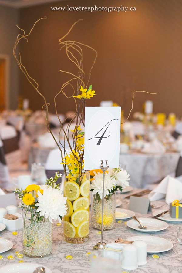 #2 Fresh Yellow Wedding Centerpiece Sculpted by Small Organic Twigs and Freshness