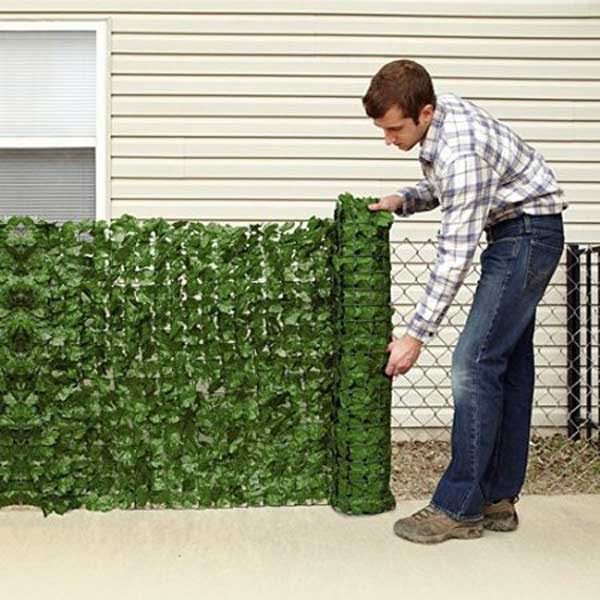 12. FAUX GREEN PRIVACY SCREEN MOUNTED ON A WIRE FENCE