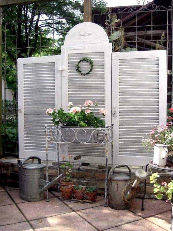 13. OLD SHUTTERS USED AS A PRIVACY SCREEN
