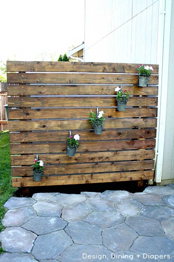 21 Wooden Pallets Used In A Vertical Green Wall