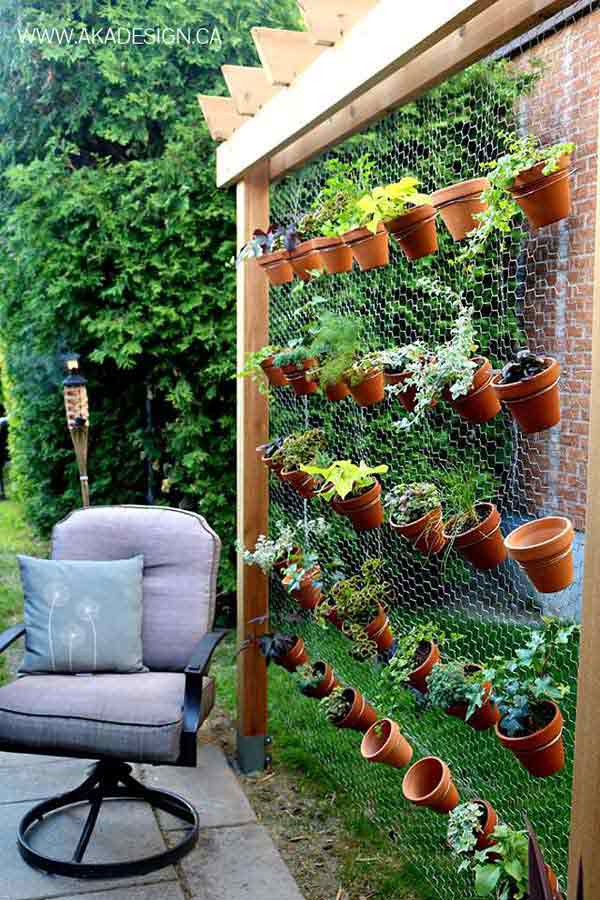 Pergola Design Featuring Green Vertical Pot Wall
