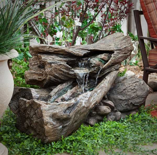 Sculptural Tree Logs Animated By Water