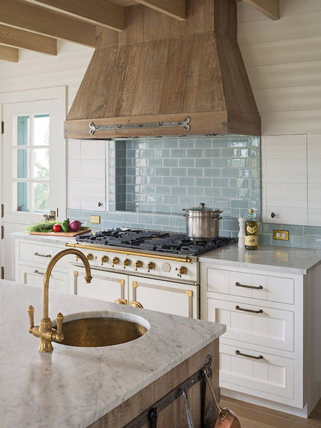 Turquoise blue subay tile behind range in gorgeous kitchen with rustic range hood. Come see 36 Best Beautiful Blue and White Kitchens to Love! #blueandwhite #bluekitchen #kitchendesign #kitchendecor #decorinspiration #beautifulkitchen