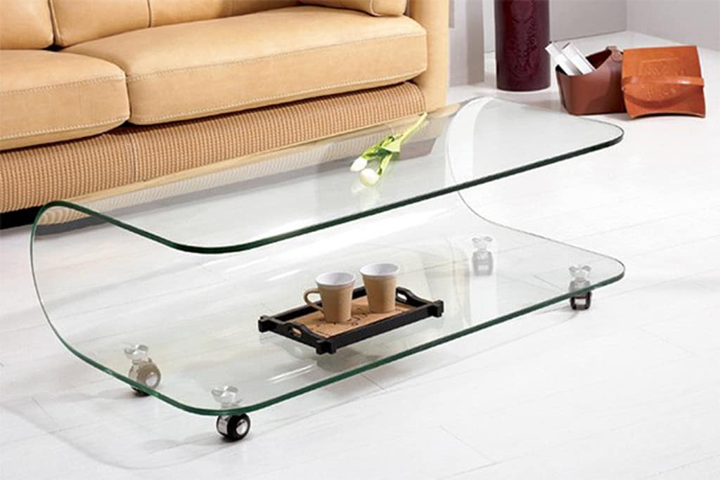 13 incredible glass top coffee table designs for Design table top konkrit