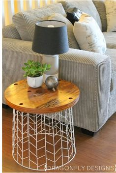 ADD A WOODEN SLICE TO A TRASH CAN AND VOILA A PERFECT SIDE TABLE