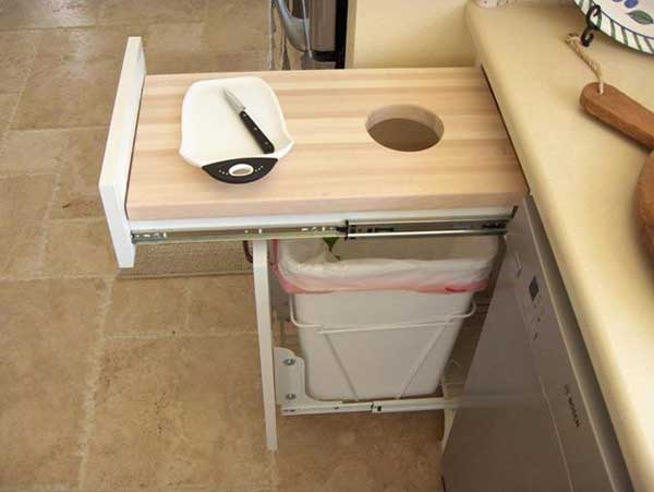 #2 CREATE A PULL OUT CUTTING BOARD WITH A TRASH CAN UNDERNEATH