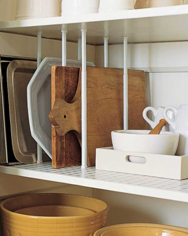 #31 USE DIVIDERS LIKE TENSION CURTAIN RODS OR CUTTING BOARDS TO ORGANIZE YOUR STORAGE