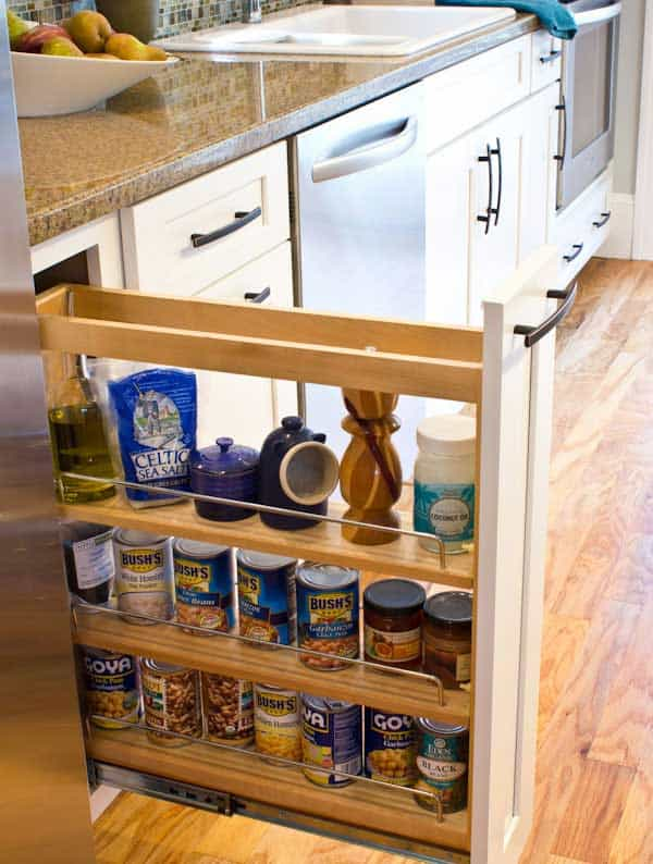#4 USE A NARROW PULL OUT DRAWER TO STORE CANS AND BOTTLES