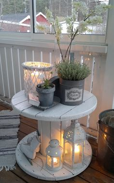 Use an old wooden cable spool, paint it white, decorate it with your  favorite candles,herbs and luminaries and use it as the perfect coffee table .