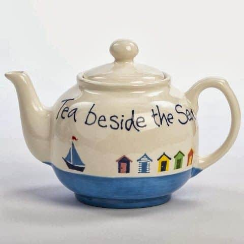 #10 POTTERY PAINTED TEA POT DEPICTING A PLACE BY THE SEA