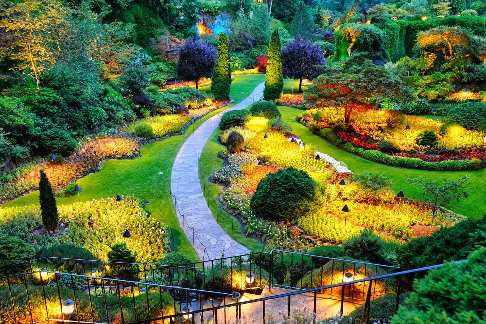 13 of the most beautifully designed flower gardens in the world 5 designed flower garden glowing from the reflection of yellow decorative lights before dark izmirmasajfo