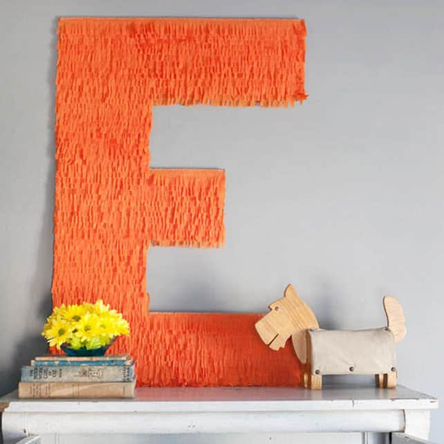 #21 FRINGE USED ON ONE SIDE OF THIS LARGE MONOGRAM TO ENHANCE A BLANK WALL