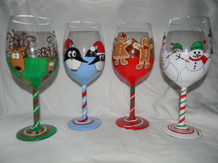 #6 'TIS THE SEASON TO BE JOLLY' WHICH IS WHAT INSPIRED THIS ARTIST TO CREATE THIS WINE GLASS IDEA