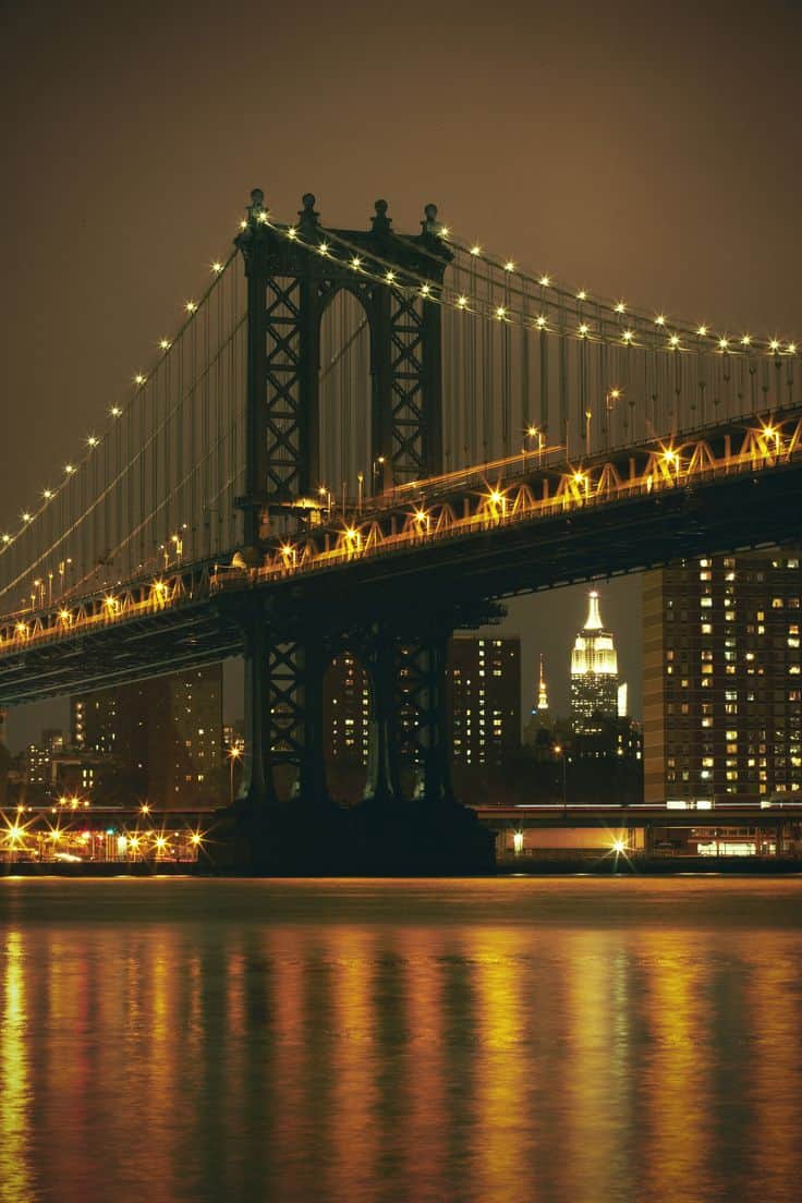 #11 The Brooklyn bridge at night standing over the east river in New York