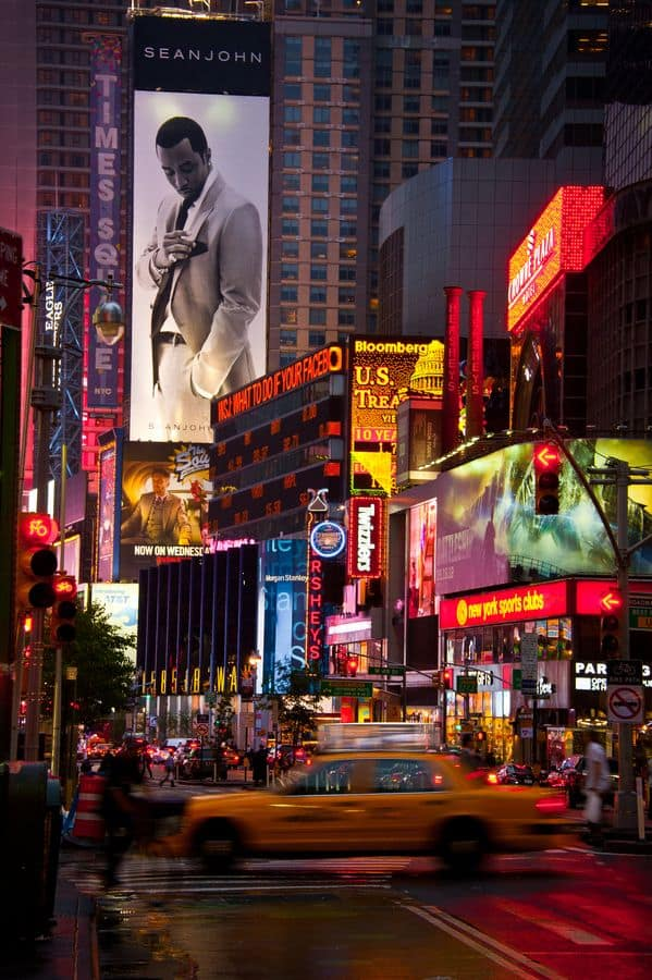 #4 An image of Sean John over looking the busy streets of times square