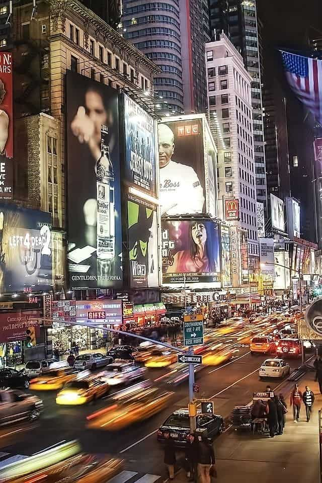 #10 Times Square  with its many lighted billboards and variety of stores capturing the spirit of New York city