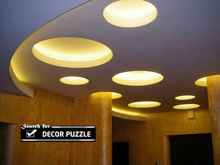 #5 GYPSUM FALSE CEILING DESIGN WITH CIRCULAR SHAPES BELOW YELLOW LIGHTING