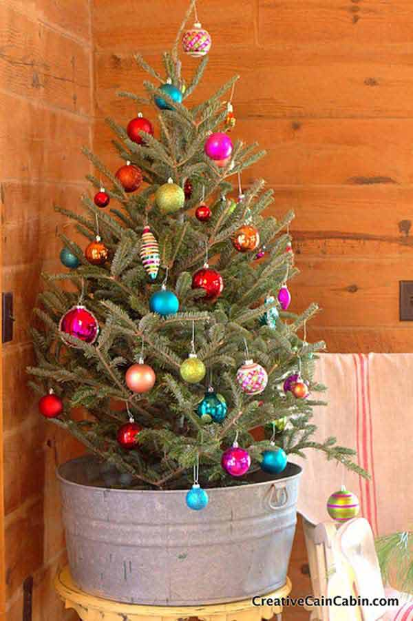 #21 YOUR CHRISTMAS TREE CAN BE NESTLED IN A GALVANIZED BUCKET