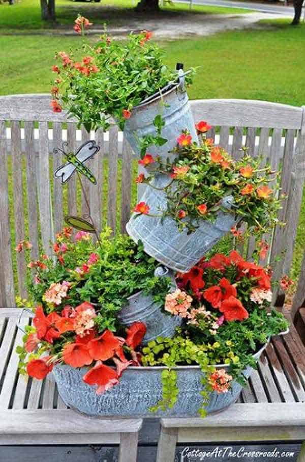 #8 CREATE GRAVITY DEFYING PLANTER INSTALLATIONS OUT OF GALVANIZED BUCKETS