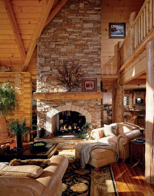 12 Fancy Log Cabin With Leather Sofa And Stone Fireplace