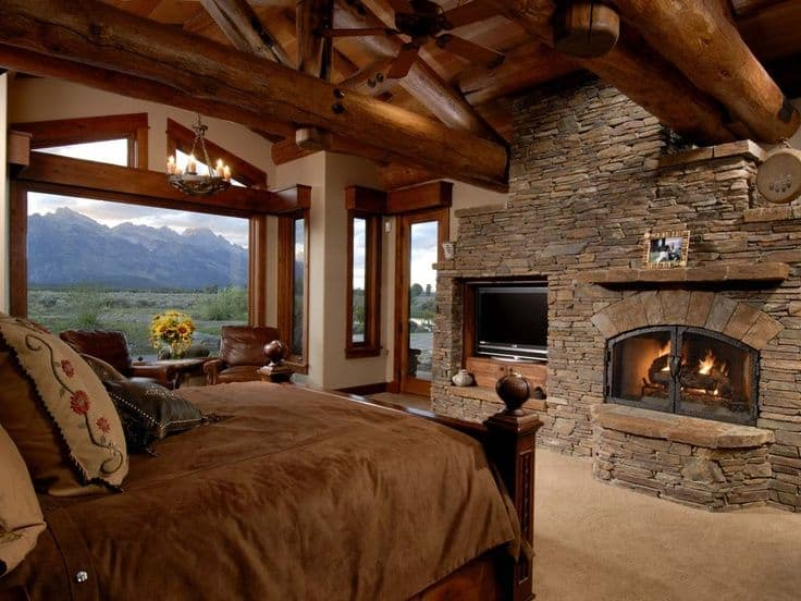 38 rustic country cabins with a stone fireplace for a for Rustic romantic bedroom