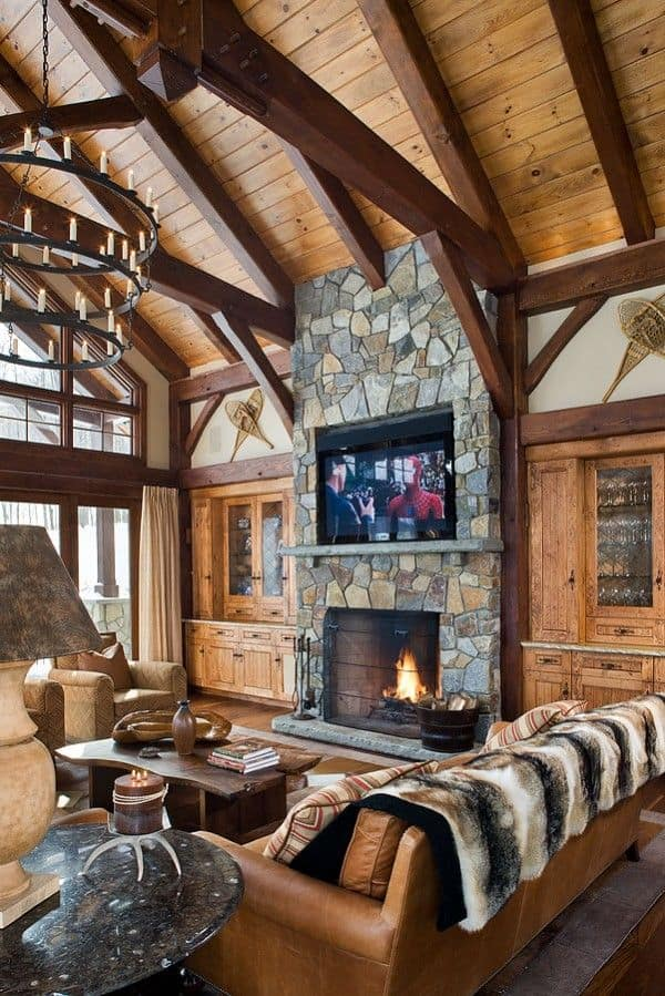 38 rustic country cabins with a stone fireplace for a for Log cabin fireplace designs