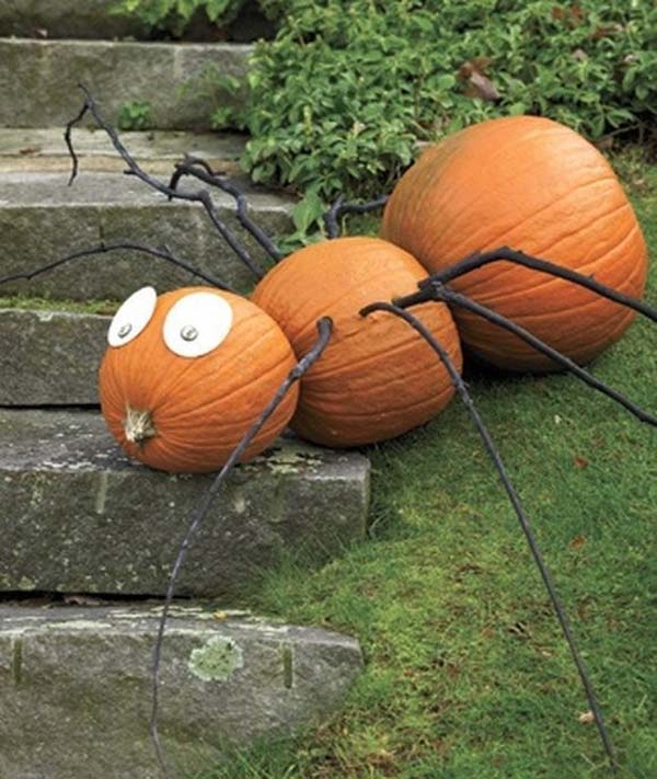 #6 TRANSFORM THREE PUMPKINS INTO A SPIDER WITH THE HELP OF BLACK PAINTED BRANCHES