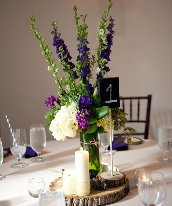 #7 simple wine bottle vase centerpiece with candles and slices of logs