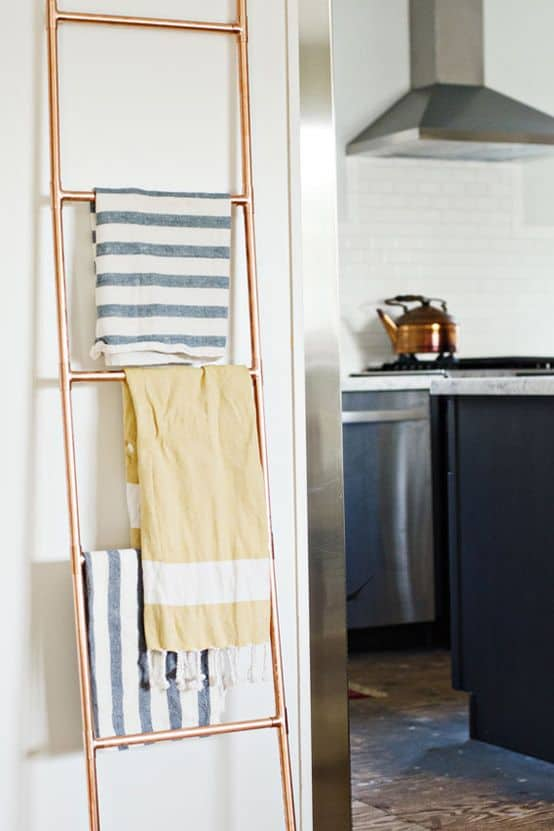 PICTURE HANGING YOUR USED TOWELS ON A COPPER PIPE