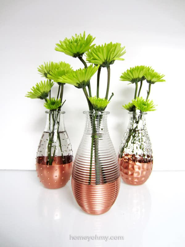 OR THESE DIY COPPER DIPPED VASES FOR SOME ELEGANT DÉCOR