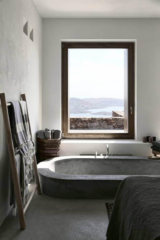 Twin Holiday Homes Forged Into Rock Overlooking The Aegean homesthetics architecture (7)