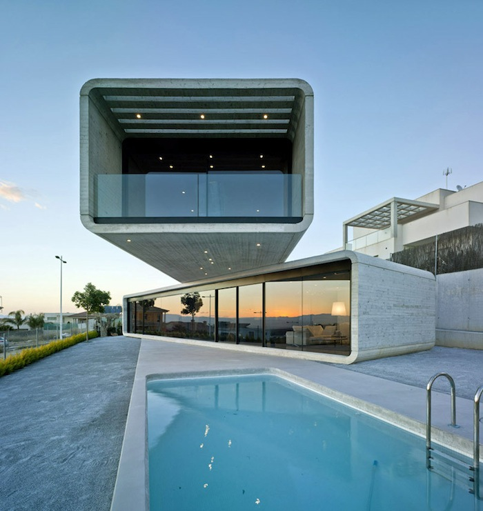 Two Cement Volumes Entitled The Crossed House By Clavel Arquitectos homesthetics architecture 1