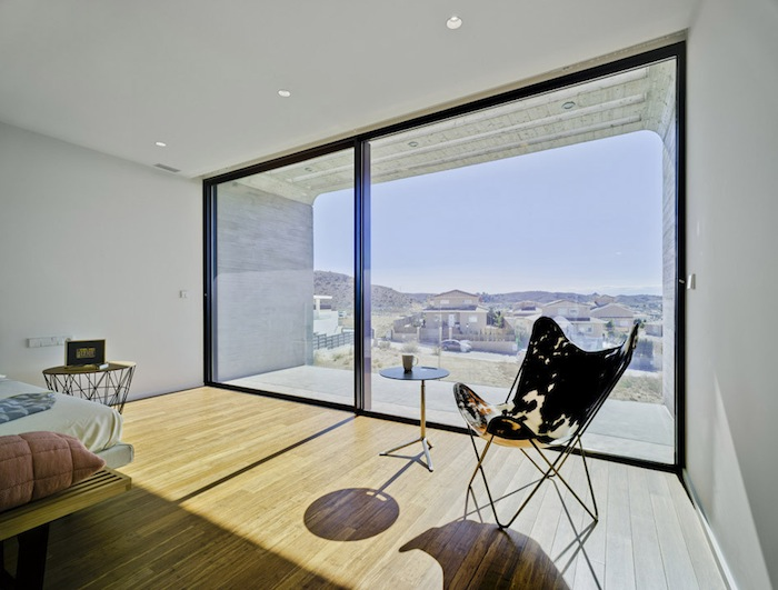 Two Cement Volumes Entitled The Crossed House By Clavel Arquitectos homesthetics architecture (4)