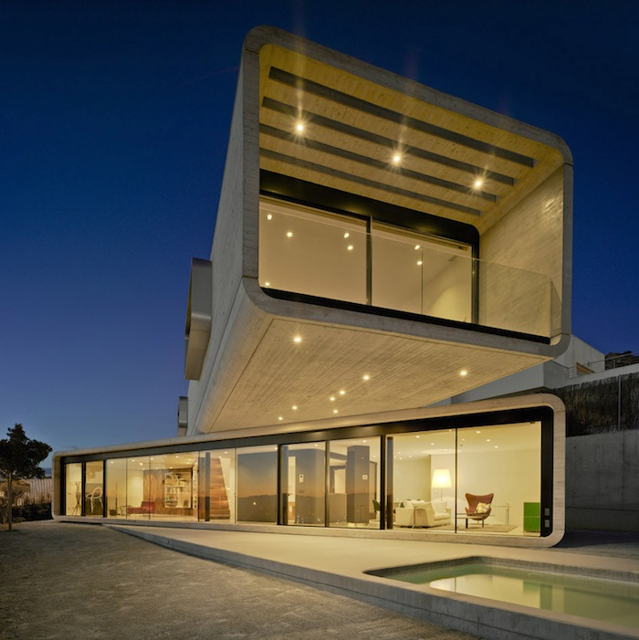Two Cement Volumes Entitled The Crossed House By Clavel Arquitectos homesthetics architecture (6)