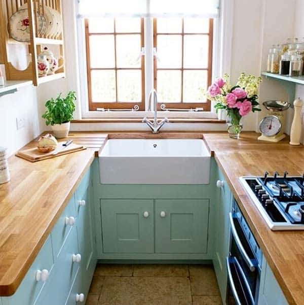 kitchen designs for small homes. Wood counter tops on teal furniture nestled between white walls  19 Beautiful Showcases of U Shaped Kitchen Designs for Small Homes