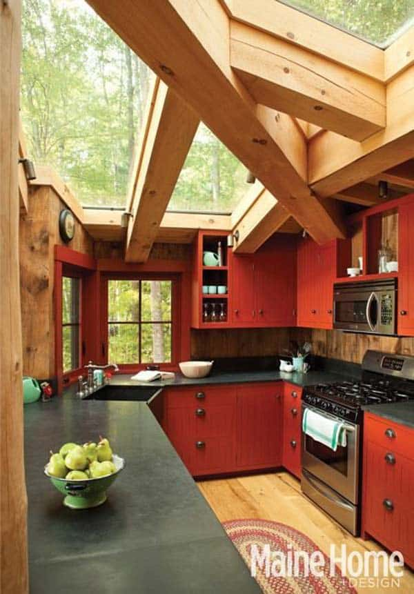 MASSIVE WOODEN BEAMS SHELTERING A KITCHEN WITH A GLASS ROOF