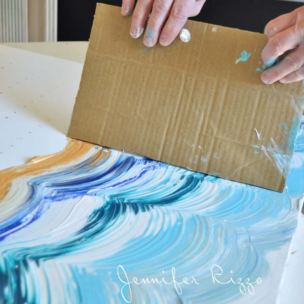 23. MIX PAINT TONES USING A PIECE OF CARDBOARD AND CREATE A WAVE EFFECT