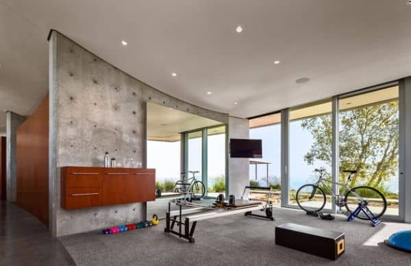An Industrial Home Gym Design With Expansive Views.