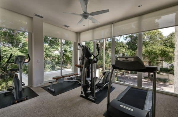 An Ethereal Airy Ambiance Can Be Obtained With Huge Glass Walls In Your Home  Gym.