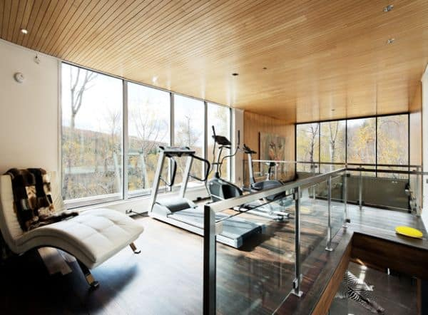 home gym with wooden ceiling and floors and expansive views