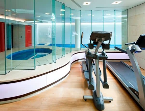 Elegant home gym with swimming pool area and Jacuzzi.