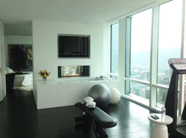 Little sleek exercise area with extraordinary view tied to the home spa in direct connection with the bedroom.