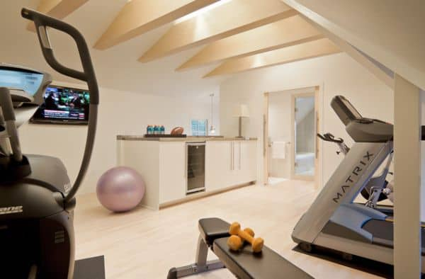 Small kitchenette in the attic home gym ready to serve you water and energy drinks.