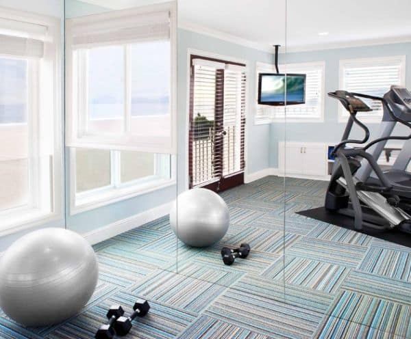 Orientate your gym equipment towards interesting views and dim the decor of the space down to maintain proper focus.