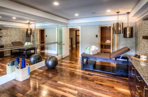 Elegant wooden floors and mirror wall can forge a welcoming ambiance in your home gym.