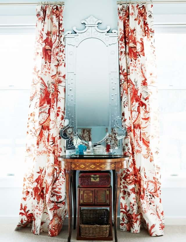 elegant mirror framed by curtains