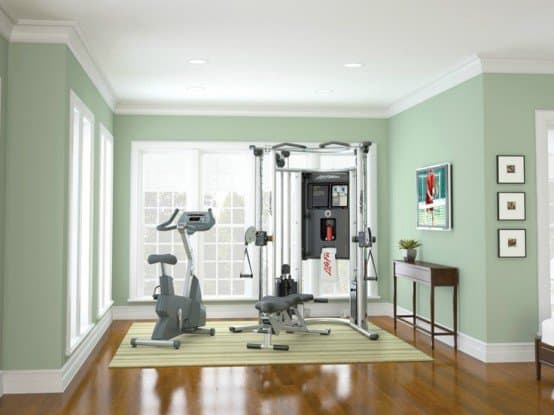 Simple green mint space sheltering a home gym. Find space for yours today.