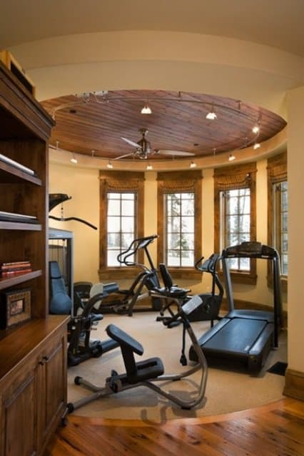 Rustic decor home gym with beautiful expansive views. Breathtaking.