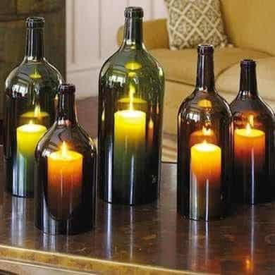 Hurricane candles with empty wine bottles