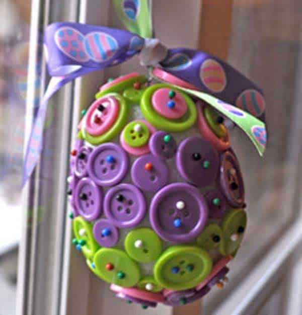 use buttons on an egg shaped from recycled paper to craft a splendid decoration